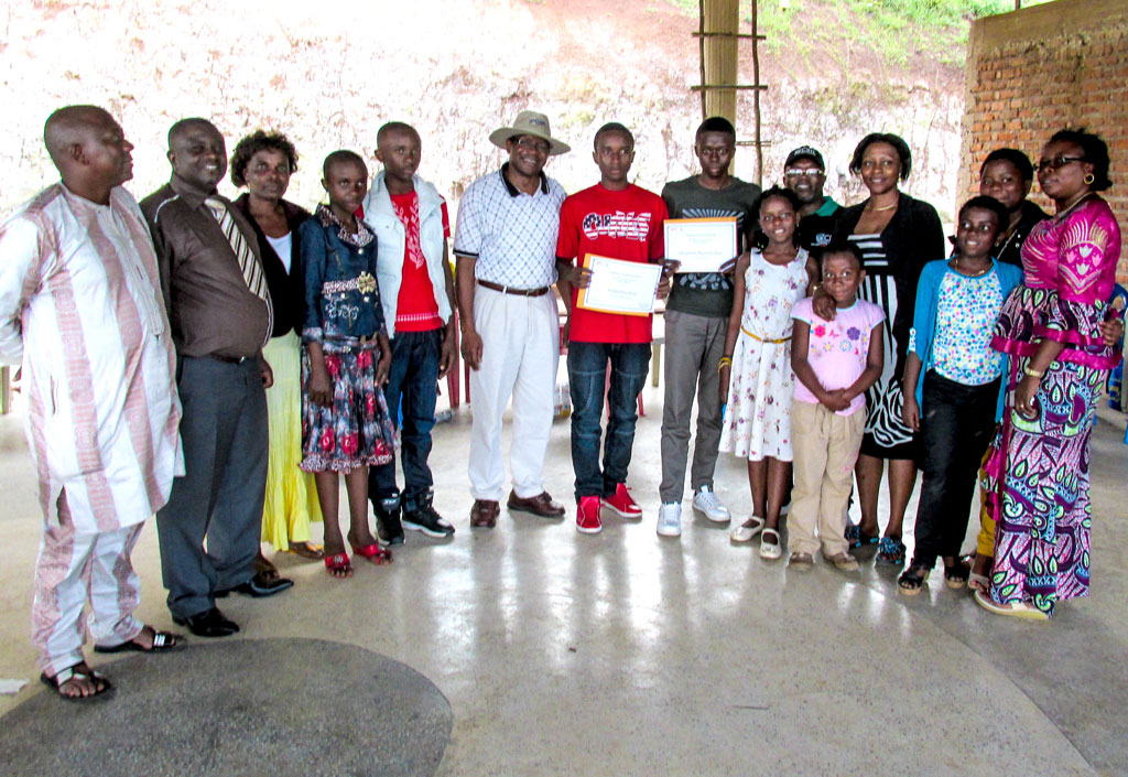 Okafor (in a hat) poses for a group photo with the winners of IITA Women Group scholarships for 2013 and their families