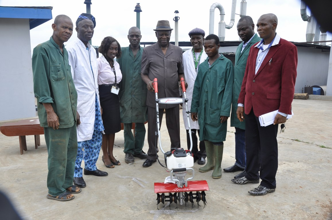 Project Leader, Cassava Weed Management, Dr Alfred Dixon with an imported motorized weeding machine flanked by IITA staff and Nigerian Engineers.