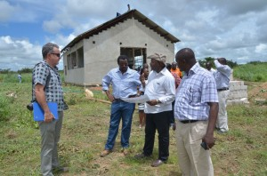 DG Sanginga conferring with Dr Chikoye on progress of construction of cassava equipment fabrication facility (at background) as Mr Bishop (at left) and Dr Ntwaruhunga (right) look on