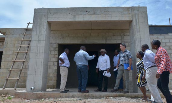 DG Sanginga being briefed by the contractor, Mr Banda, about the main research and administrative building.