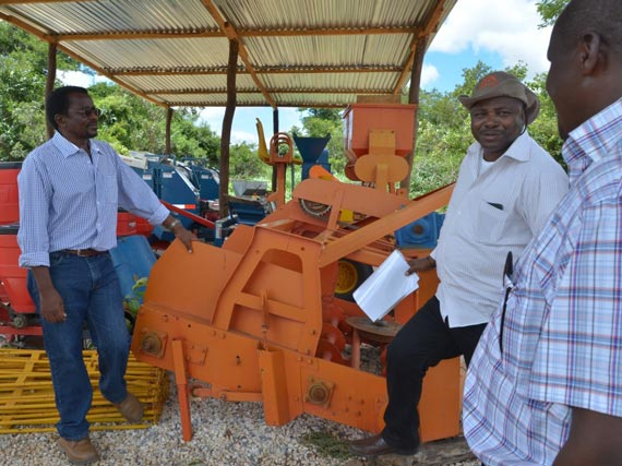 Dr Chikoye, Dr Sanginga, and Dr Ntwaruhunga discussing about the cassava and soybean planting, harvesting, and processing equipment stored at the SARAH site.