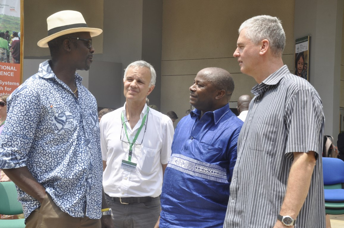 Frank Rijsberman (rightmost) in a huddle with (L-R) Dr Kwesi Attah-Krah, IITA Board Member Roel Merckx, and DG Nteranya Sanginga after the meeting in Ibadan.