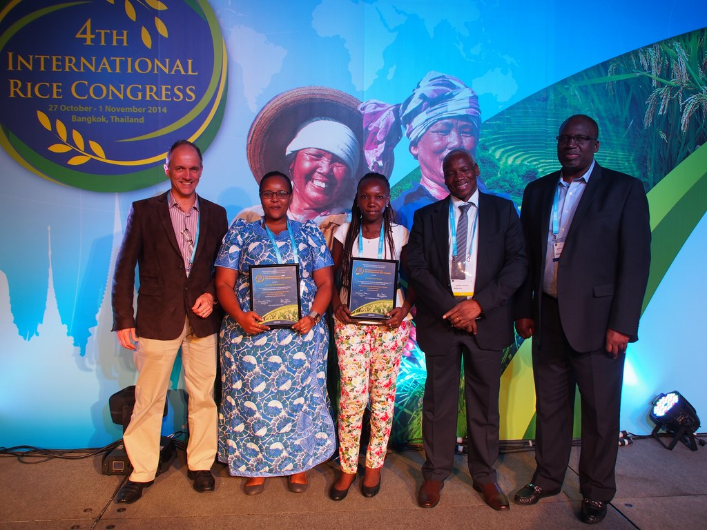 Ms Gaudiose Mujawamariya and Ms Esther Achandi being honored with the Young Rice Scientists Award at the Fourth International Rice Congress 2014 in Bangkok, Thailand.
