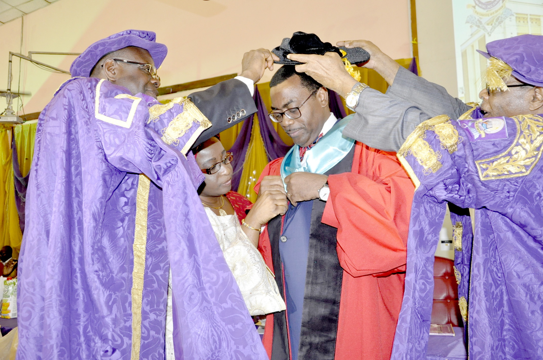 Dr Akinwumi Adesina receiving his cap and gown during the conferment ceremony.