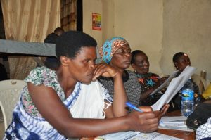 Participants reading the district agrometeorological information brochures provided to them during the meeting in Killolo district